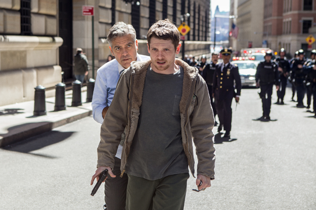 Lee Gates (George Clooney) is held hostage by Kyle Budwell (Jack O'Connell) as police Captain Marcus Powell (Giancarlo Esposito) and his fellow officers follow behind on the streets of New York in TriStar Pictures' MONEY MONSTER.
